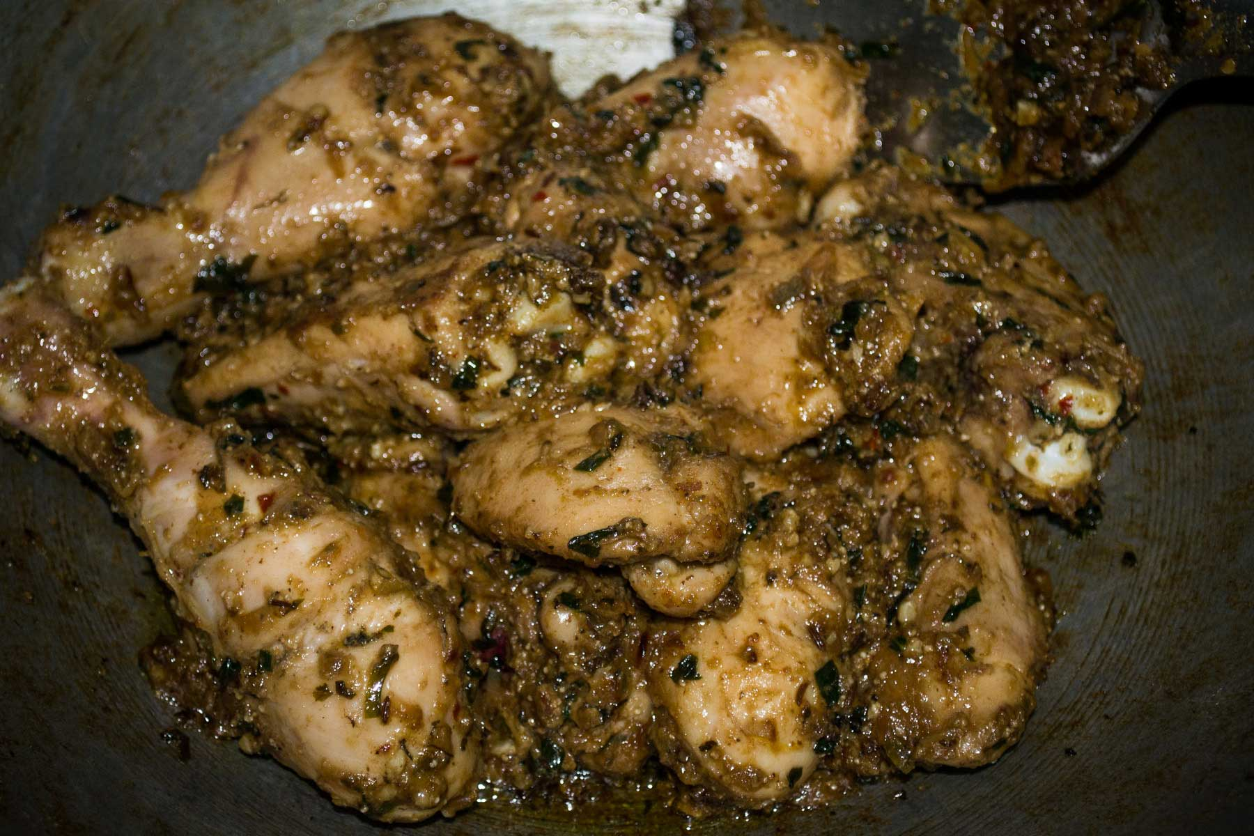 Cooking chicken with spices for Methi Malai Chicken
