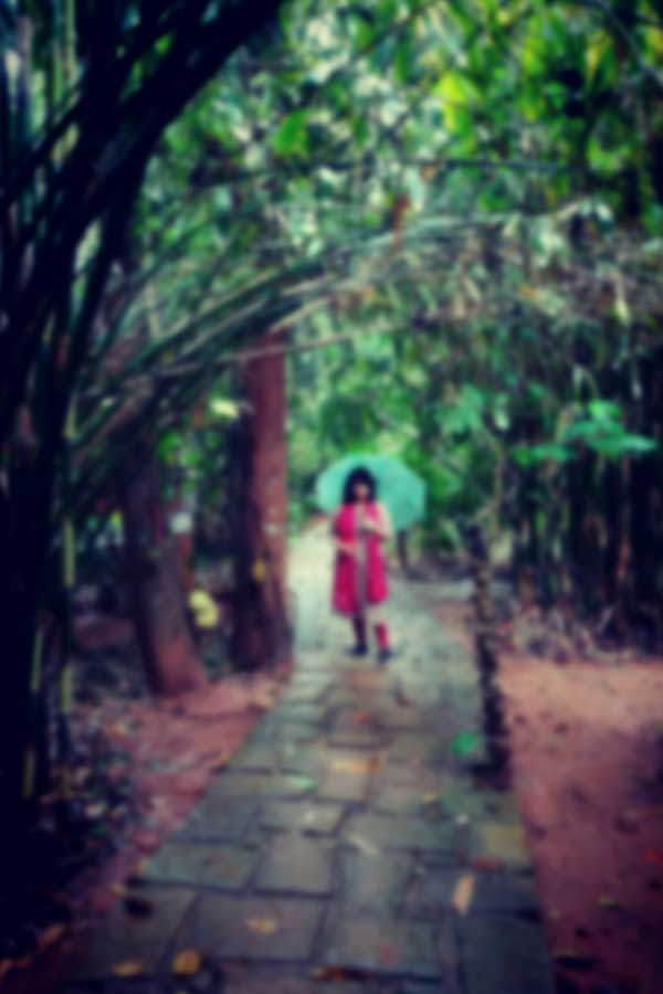 Sanchari standing in the rain